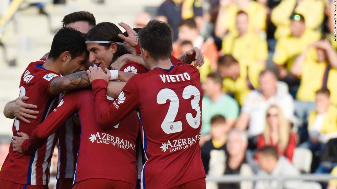 Atletico Madrid's Brazilian defender Filipe Luis celebrates his goal in the 3-0 win at Las Palmas which kept Real's city rival at the top of the La Liga standings.