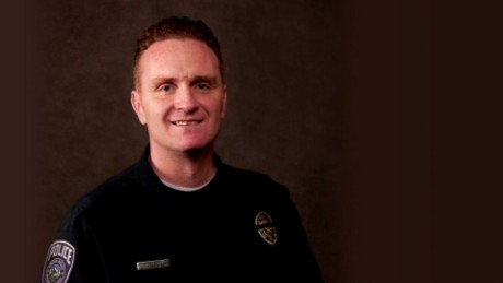 Officer Douglas Barney, 44, was taken to a hospital, where he died of his injuries.