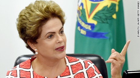 Brazilian President Dilma Rousseff  speaks during a meeting at Planalto Palace in Brasilia on November 27, 2015 to discuss the situation of the dam burst in Mariana, Minas Gerais state. Rousseff will attend the UN Climate Conference - COP21 - in Paris, France which begins on November 30th. AFP PHOTO/EVARISTO SA / AFP / EVARISTO SA        (Photo credit should read EVARISTO SA/AFP/Getty Images)