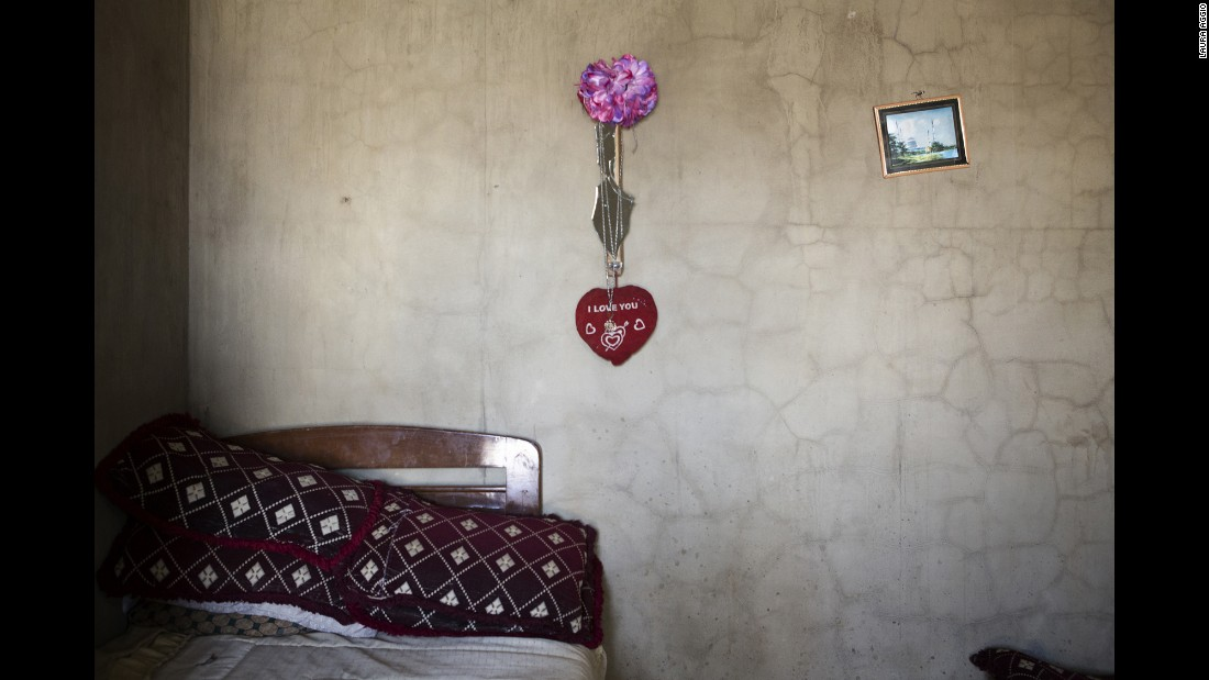 A heart hangs over a bed at a refugee camp in the Bekaa Valley.