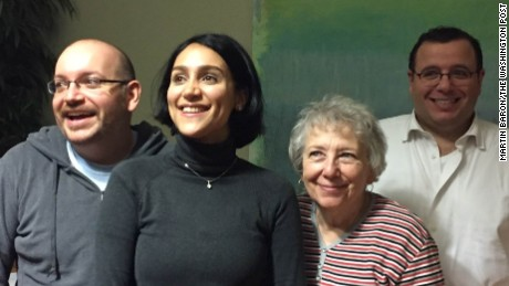 The Washington Post's Jason Rezaian, left, reunites with his family in Germany.