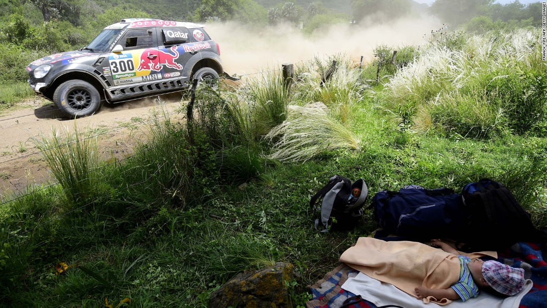 A baby sleeps by the side of the road during the 12th stage of the Dakar Rally, which took place Friday, January 15, between the Argentine cities of San Juan and Villa Carlos Paz.