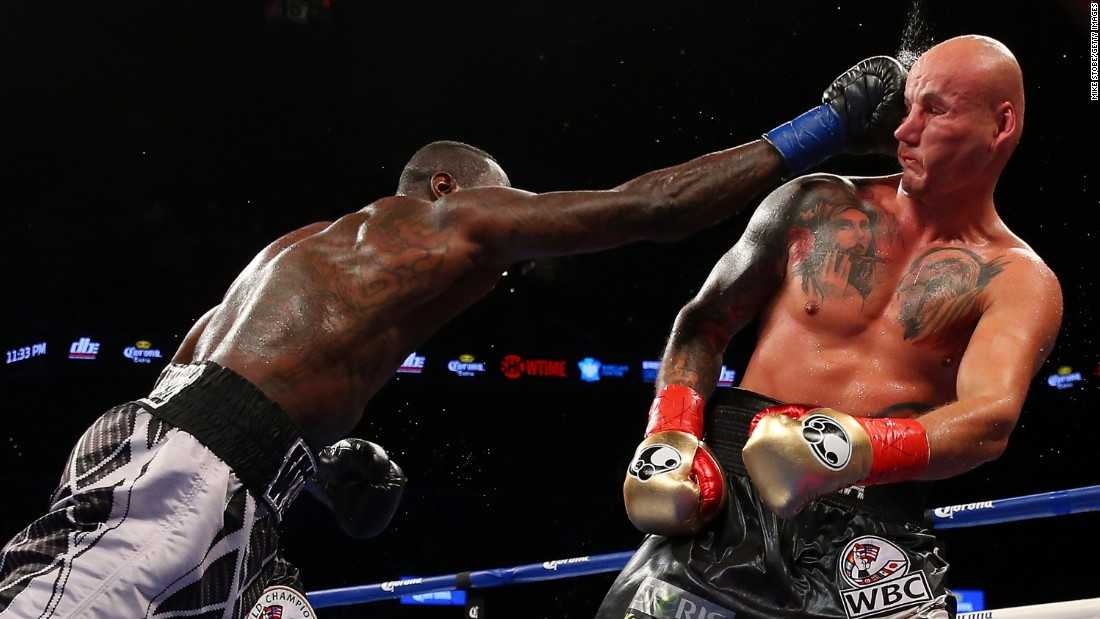 Deontay Wilder punches Artur Szpilka during a heavyweight title fight in New York on Saturday, January 16. Wilder defended his WBC belt with a ninth-round knockout.
