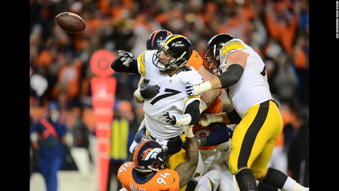 Denver Broncos linebacker DeMarcus Ware, bottom, sacks Pittsburgh quarterback Ben Roethlisberger during an NFL playoff game in Denver on Sunday, January 17. Roethlisberger was ruled down before he shoveled the ball away. The Broncos advanced to the AFC Championship with a 23-16 victory.