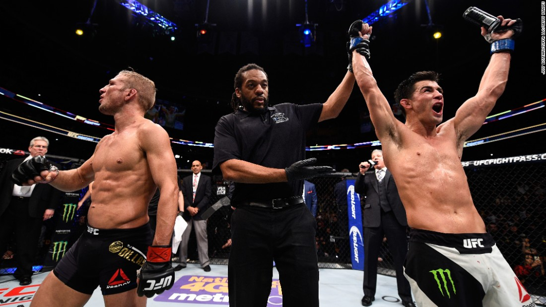 Referee Herb Dean raises the hand of Dominick Cruz after Cruz defeated T.J. Dillashaw to win the UFC bantamweight title in Boston on Sunday, January 17. Cruz won by split decision, regaining the title that was stripped from him because of injuries.