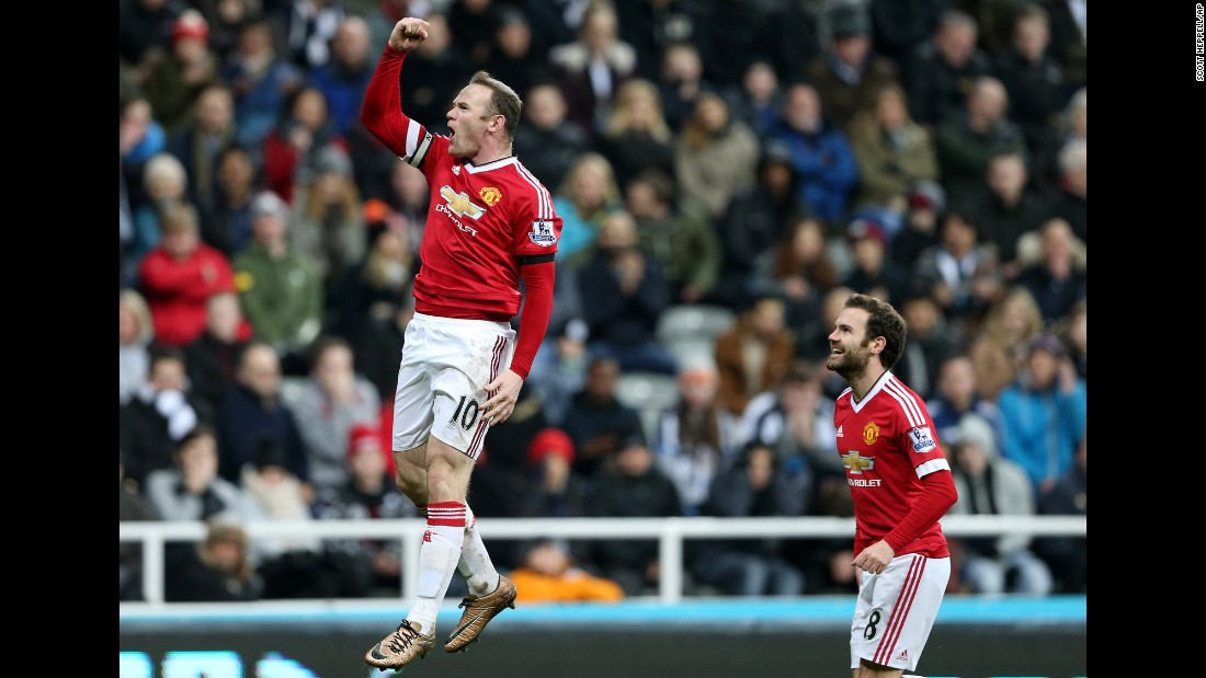 Manchester United's Wayne Rooney punches the air Tuesday, January 12, after scoring a goal against Newcastle in Newcastle upon Tyne, England. Rooney had two goals in the Premier League match, which ended 3-3.