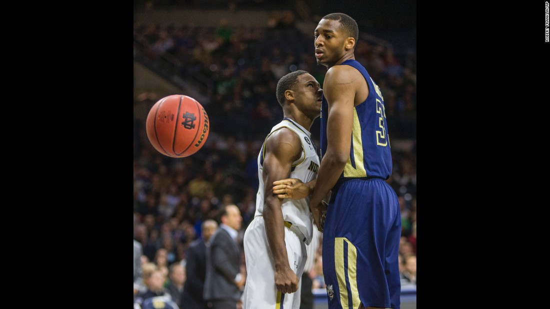 Notre Dame's Demetrius Jackson, left, looks at Georgia Tech's James White after dunking the ball Wednesday, January 13, in South Bend, Indiana.