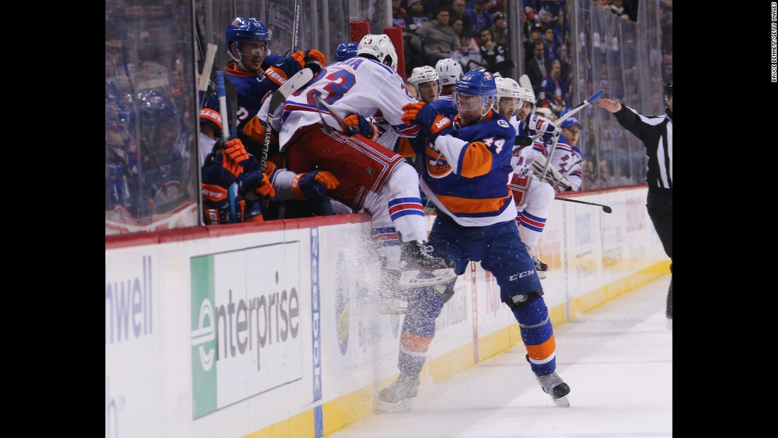 "Calvin de Haan checks Jayson Megna into the boards during an NHL game in New York on Thursday, January 14. <a href=""http://www.cnn.com/2016/01/12/sport/gallery/what-a-shot-sports-0112/index.html"" target=""_blank"">See 33 amazing sports photos from last week</a>"