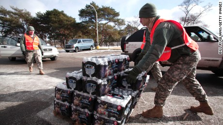 FLINT, MI - JANUARY 17:  Soldiers from the Michigan Army National Guard Flint prepare to give Flint residents bottled water at a fire station January 17, 2016 in Flint, Michigan. U.S. President Barack Obama declared a federal emergency in Michigan, which will free up federal aid to help the city of Flint with lead contaminated drinking water. Michigan Gov. Rick Snyder requested emergency and disaster declarations after activating the National Guard to help the American Red Cross distribute water to residents.  (Photo by Bill Pugliano/Getty Images)