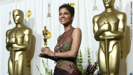 "402719 181: Actress Halle Berry poses with her Best Actress in a Leading Role Oscar for ""Monster's Ball"" backstage during the 74th Annual Academy Awards March 24, 2002 at The Kodak Theater in Hollywood, CA. (Photo by Frederick M. Brown/Getty Images)"