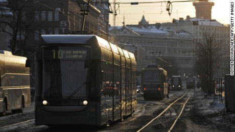 A tram passes through central Helsinki.