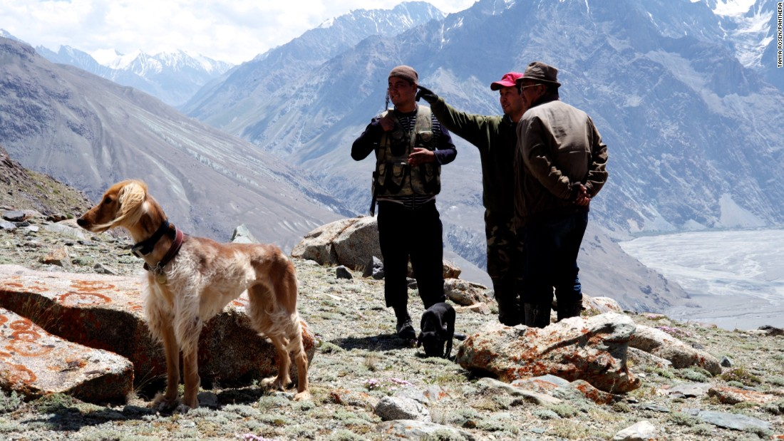 "Members of the conservation group ""Ming Teke"" discuss with Panthera's Zairbek Kubanychbekov where to place camera traps to monitor snow leopards and their prey."