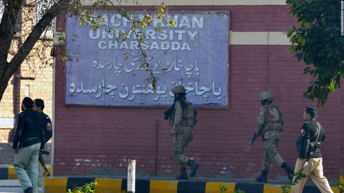 Soldiers conduct a search operation at the university.