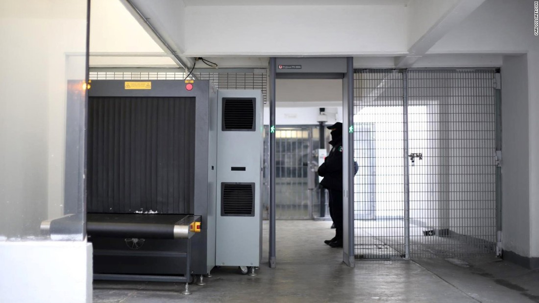 An X-ray machine is guarded at the prison's entrance.<br />