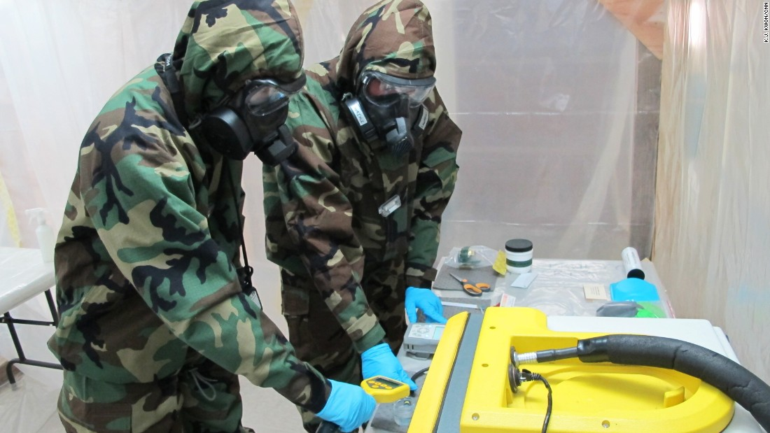 Soldiers test samples collected in the drill at a temporary field lab.