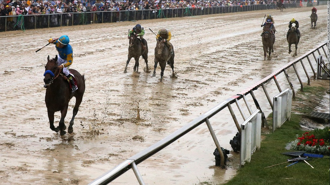 MAY 16 2015: In a mud bath of a track, Espinoza lifts his arm in victory at the Preakness Stakes in Baltimore -- part two of the three races that make up America's Triple Crown.