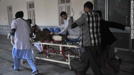 Pakistani rescuers transfer an injured man at a hospital following an attack by gunmen at Bacha Khan university in Charsadda on January 20.