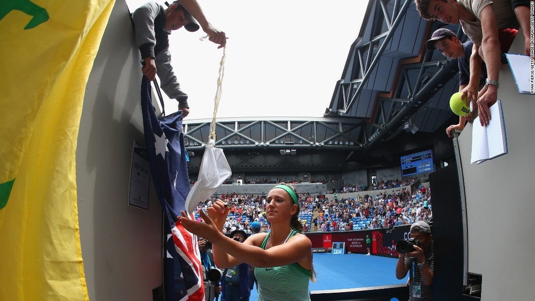 Victoria Azarenka signed autographs after thumping Danka Kovinic in the second round.