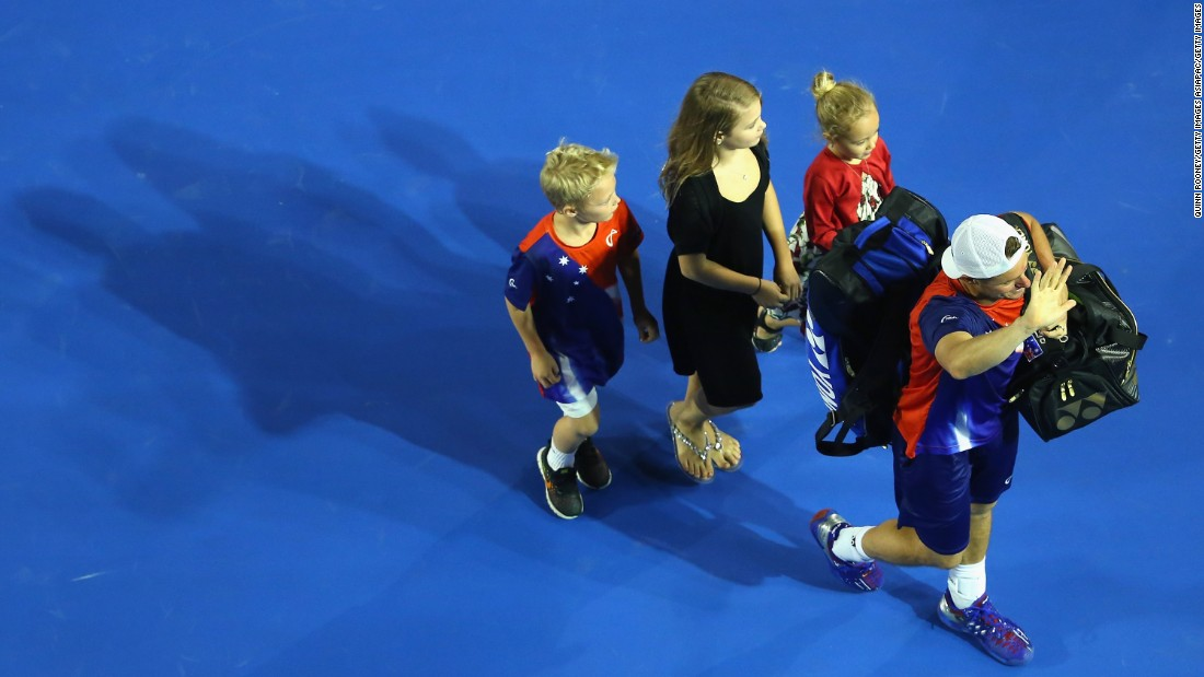 Lleyton Hewitt bid a fond farewell to the Australian Open crowd as he left the stadium with his family.