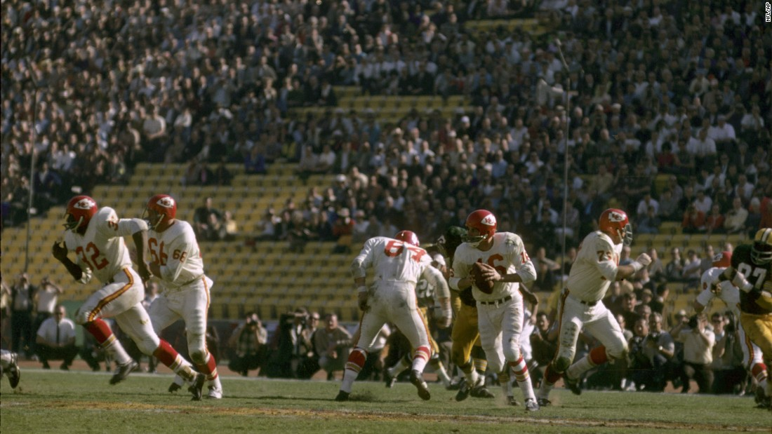 "Chiefs quarterback Len Dawson rolls out for a pass. Nearly 62,000 fans attended the game, but there were still a lot of empty seats. Now the Super Bowl is <a href=""http://www.cnn.com/2014/01/28/worldsport/gallery/super-bowl-tickets/index.html"" target=""_blank"">one of the most coveted tickets in sports.</a>"