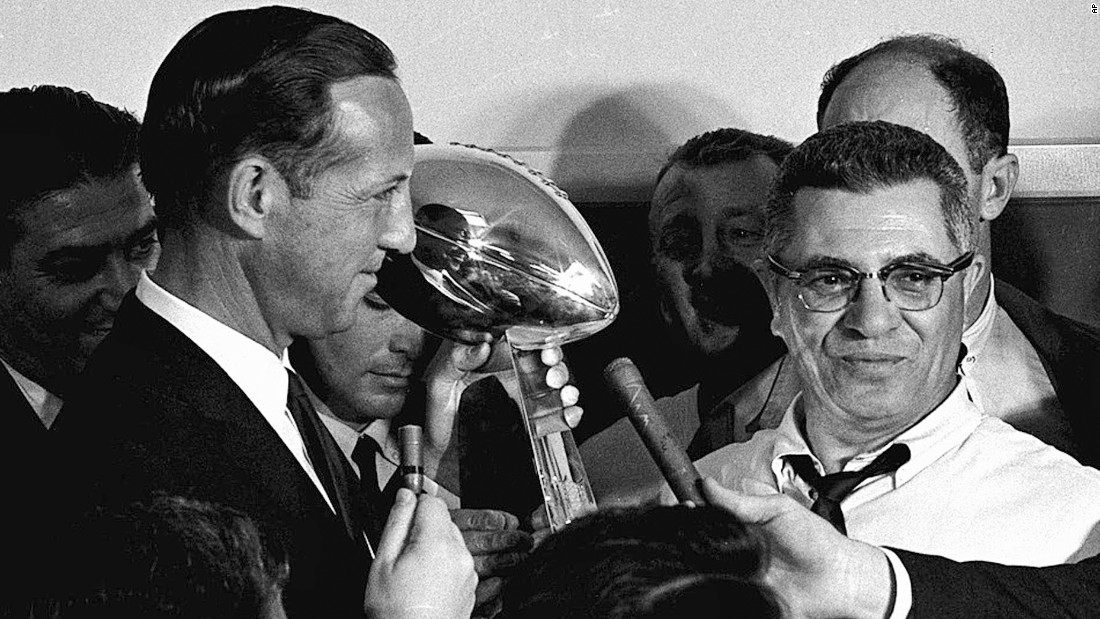 NFL commissioner Pete Rozelle, left, presents the championship trophy to Packers head coach Vince Lombardi after the game. The trophy was renamed the Vince Lombardi Trophy after the coach's death in 1970.