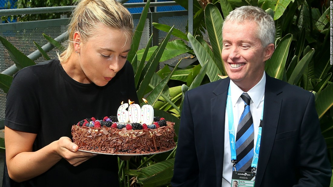 The Russian star was given a cake to mark the occasion. Tournament director Craig Tiley looks on enviously ...