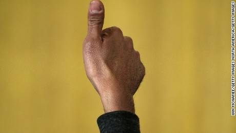 WASHINGTON, DC - FEBRUARY 26:  A guest gives a thumbs up sign as U.S. President Barack Obama delivers remarks during an event in the East Room of the White House on February 26, 2015 in Washington, DC. Obama paid tribute to African American heroes of the civil rights movement during a reception marking Black History Month.  (Photo by Win McNamee/Getty Images)