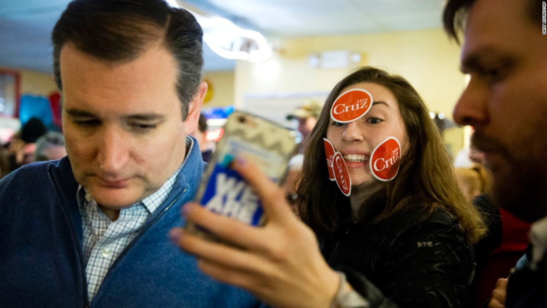 A young woman tries to get a selfie with Sen. Ted Cruz during the presidential candidate's campaign stop in Tilton, New Hampshire, on Monday, January 18.