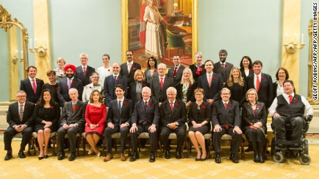 Prime Minister Justin Trudeau poses for a photo with his cabinet after being sworn in at Rideau Hall in Ottawa, Ontario, on November 4, 2015.