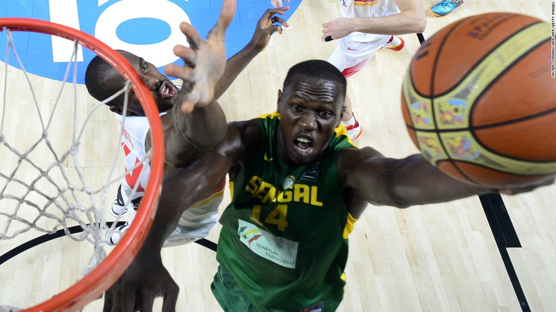 Senegal's center Gorgui Dieng -- seen dunking on Spain's forward Serge Ibaka (who was born in the Republic of the Congo) during the 2014 FIBA World basketball championships round of 16 match Spain vs. Senegal -- starred for Louisville in college and currently plays for the Minnesota Timberwolves of the NBA.