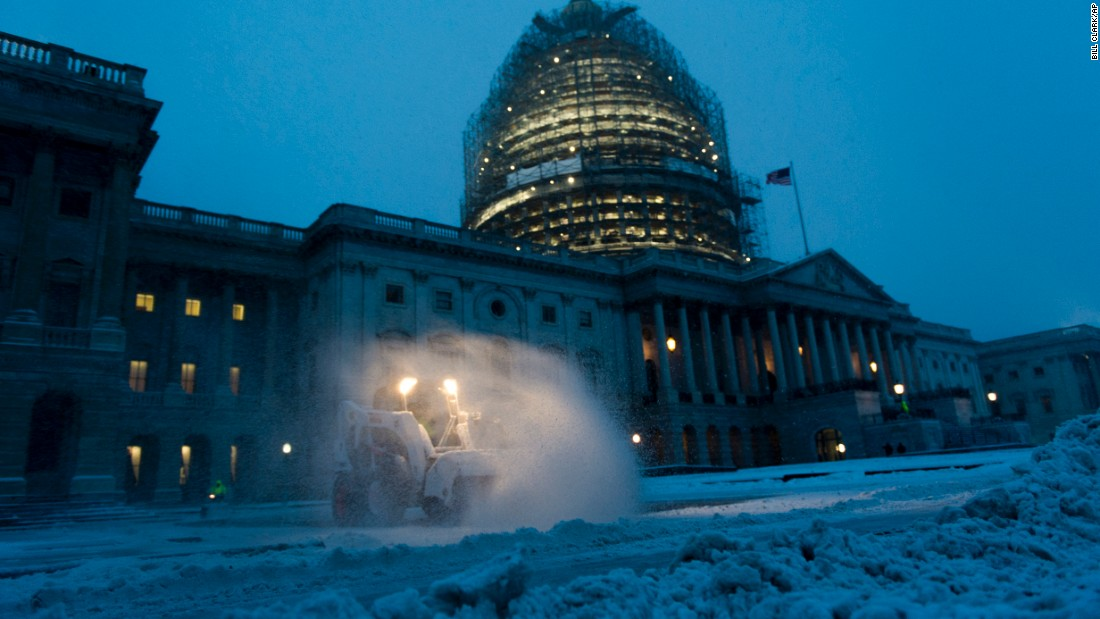 Crews clear the East Plaza at the U.S. Capitol as they try to keep up with the heavy snow on January 22.