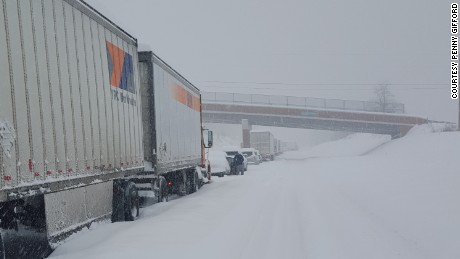 A line of cars and trucks are stuck along on the Pennsylvania Turnpike, 20 miles east of Somerset, Pennsylvania on Saturday, January 23, 2016.