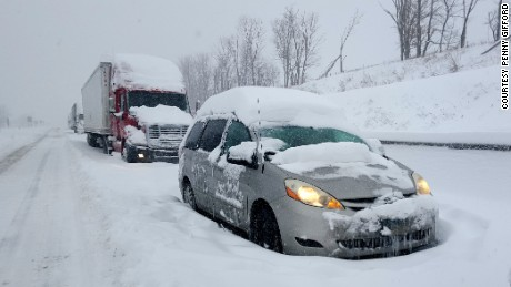 A line of cars and trucks are stuck along the Pennsylvania Turnpike, 20 miles east of Somerset, Pennsylvania.