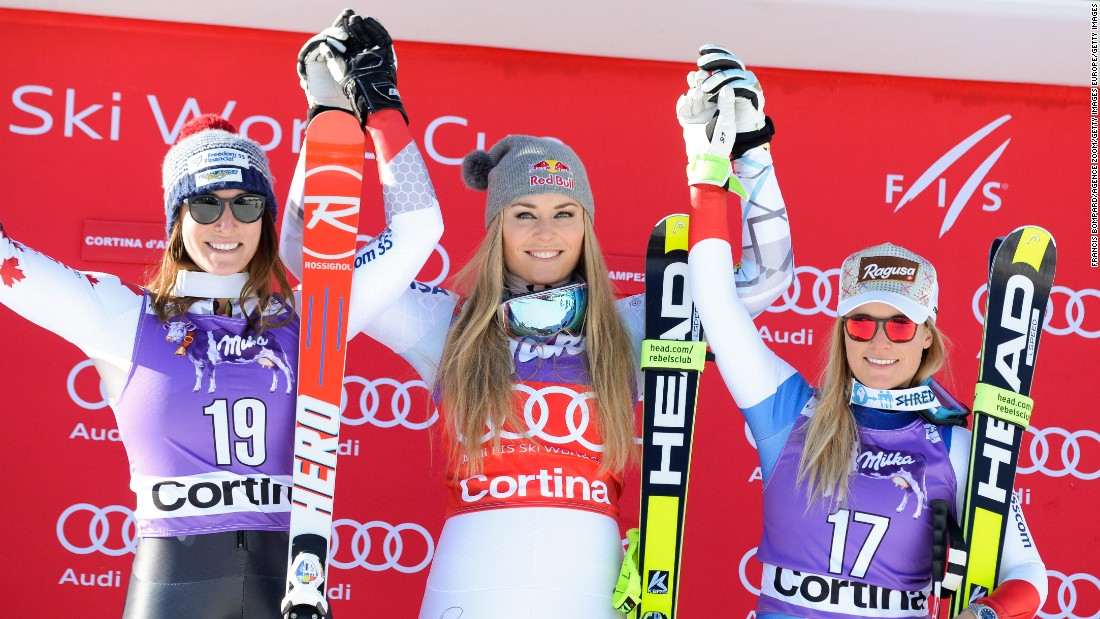 Vonn (center) stands on the podium with Larisa Yurkiw of Canada (L) and Laura Gut of Switzerland (R) who finished second and third respectively at Cortina d'Ampezzo.
