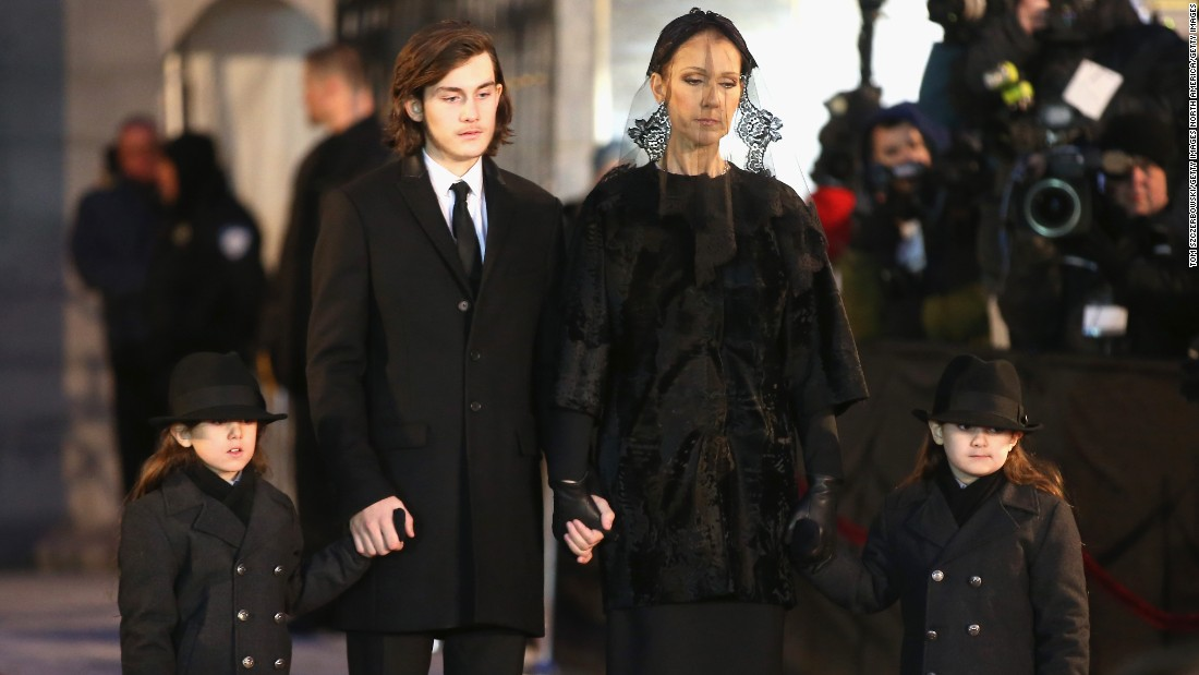 "Recording artist Celine Dion and children René-Charles and twins Eddy and Nelson attend the funeral for her husband <a href=""http://www.cnn.com/2016/01/16/entertainment/rene-angelil-celine-dion-husband-death-feat/"">René Angélil </a>at Notre-Dame Basilica in Montreal, Canada, on Friday, January 22."