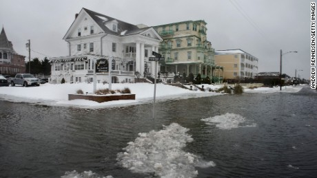 Caption:CAPE MAY, NEW JERSEY - JANUARY 23: Ice forms as the winter storm mixed with high tide causes flooding on Beach Avenue on January 23, 2016 in Cape May, New Jersey. A major snowstorm is upon the East Coast this weekend with some areas expected to receive over a foot of snow. (Photo by Andrew Renneisen/Getty Images)