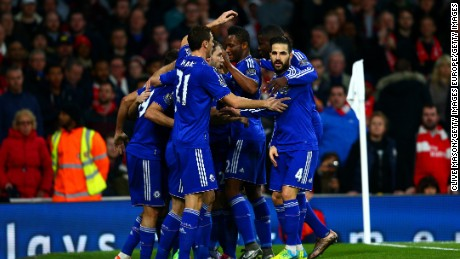 Diego Costa is mobbed by teammates after scoring the only goal of the game in the 1-0 win for Chelsea over Arsenal at the Emirates.