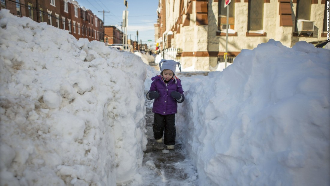 Beatrice Evangeline, 3, walks through a narrow shoveled-out path in Philadelphia on January 24.
