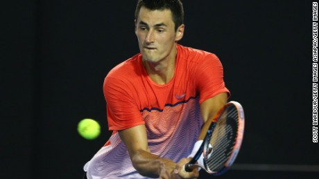 Bernard Tomic of Australia plays a backhand in his fourth round match against Andy Murray of Great Britain during day eight of the 2016 Australian Open at Melbourne Park on January 25, 2016 in Melbourne, Australia.