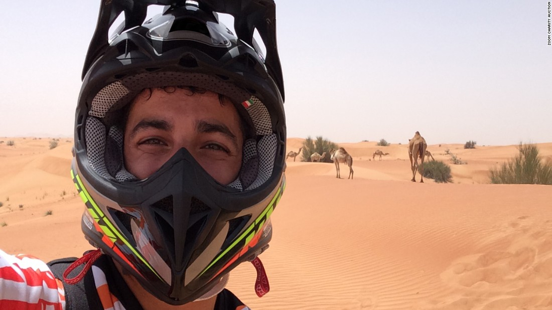 "Red Bull Racing driver Daniel Ricciardo swaps four wheels for two for this offering, explaining:  ""I love riding bikes. Always have. The speed of course is fun but what I really enjoy is the adventure. Being in the middle of the desert in this case, it's a peaceful yet exciting experience. One which involved the odd camel too!"""