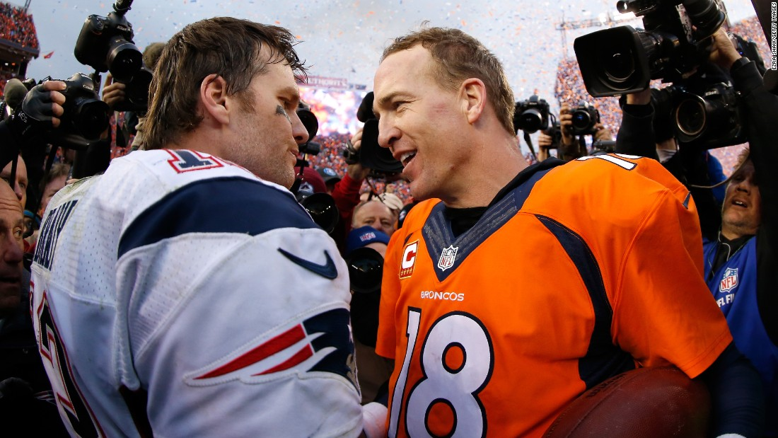 Peyton Manning, right, talks to fellow quarterback Tom Brady after the AFC Championship game in Denver on Sunday, January 24. Manning's Broncos defeated Brady's Patriots 20-18 to advance to the Super Bowl. It was the 17th time the two superstars have played against each other since 2001. Brady's teams have won 11 of those meetings, but Manning's teams have won three of the five playoff matchups.
