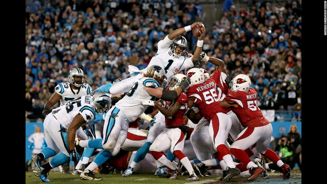 Carolina quarterback Cam Newton scores a touchdown against Arizona in the NFC Championship game on Sunday, January 24. Newton had four touchdowns -- two passing and two rushing -- to lead the Panthers to a 49-15 victory.