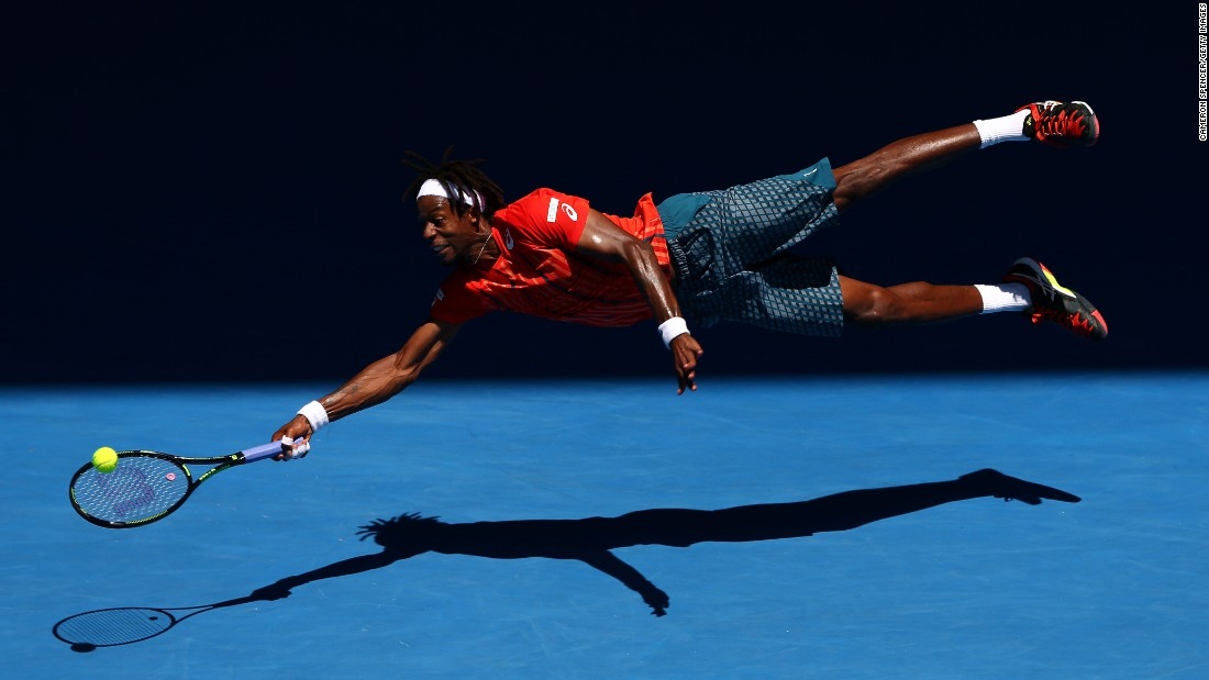 Gael Monfils dives for a forehand during his fourth-round match at the Australian Open on Monday, January 25. Monfils defeated Andrei Kuznetsov in four sets.