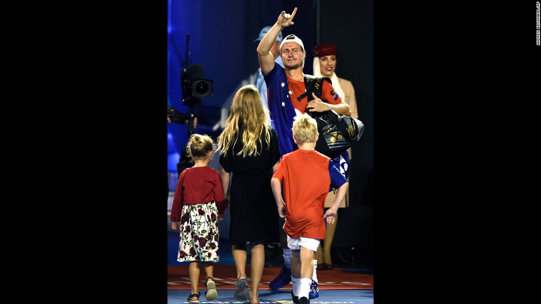Lleyton Hewitt, trailed by his children, waves goodbye Thursday, January 21, after playing his final singles match at the Australian Open. Hewitt is retiring at the end of this season. During his career, the Australian won Wimbledon and the U.S. Open, and he was once the No. 1 player in the world.