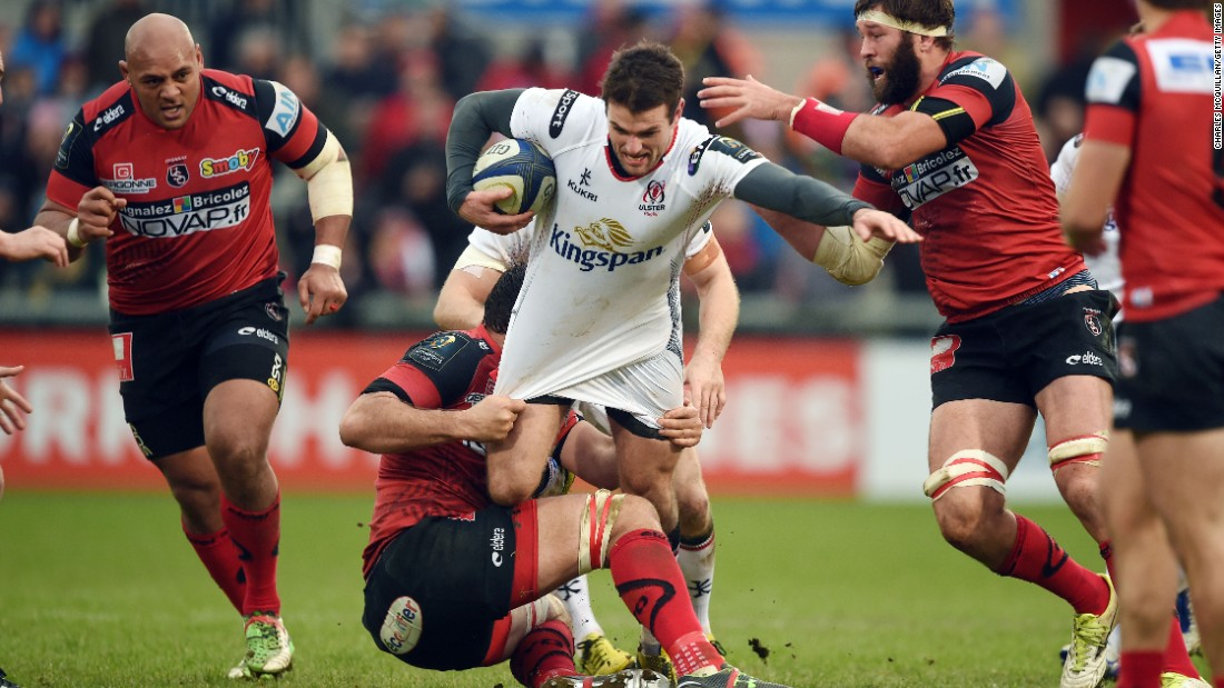 Ulster's Jared Payne bursts through the Oyonnax defense Saturday, January 23, during a Champions Cup match in Belfast, Northern Ireland.