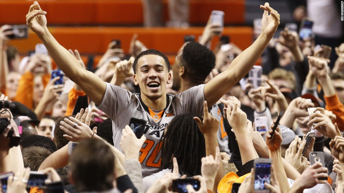 Oklahoma State guard Jeffrey Carroll celebrates with fans after the Cowboys defeated Kansas on Tuesday, January 19.