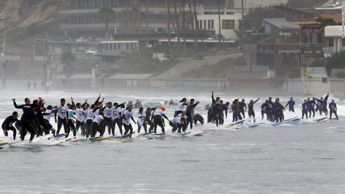 "Surfers in La Jolla, California, try to ride the same wave to set a new Guinness World Record on Saturday, January 23. <a href=""http://timesofsandiego.com/sports/2016/01/23/san-diego-misses-world-record-most-surfers-on-single-wave/"" target=""_blank"">They came up short.</a>"
