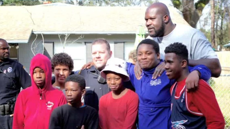 Shaquille O'Neil shoots hoops with neighborhood kids