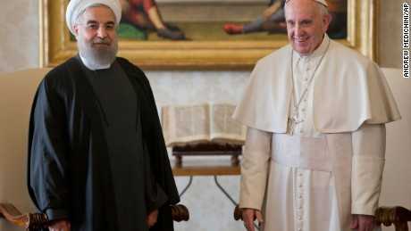Pope Francis and Iranian President Hassan Rouhani pose for photographers at the Vatican on Tuesday, January 26.