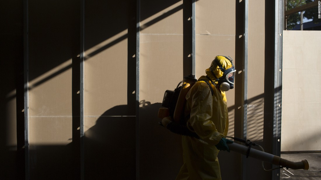 A health worker sprays insecticide under the bleachers of Rio de Janeiro's Sambadrome on Tuesday, January 26.